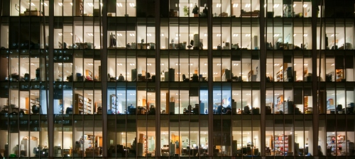 illuminated-offices-through-glass-windows-at-night-1